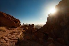 Man greets the sunrise on Mount Sinai. Man greets the beautiful sunrise on Mount Sinai in Egypt royalty free stock photo