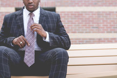 Man in Grey and Black Suit Jacket Sitting on Bench Stock Images
