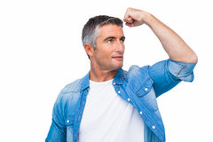 Man with grey hair tensing arm muscle Stock Images
