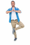 Man with grey hair in tree pose Royalty Free Stock Photo