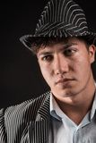 A man in a grey hat on  black background Royalty Free Stock Photo