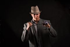 A man in a grey hat on black background Royalty Free Stock Photography