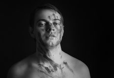 Man with grey paint on his face. Royalty Free Stock Images