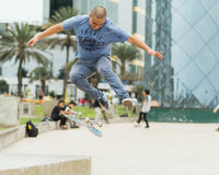 Man in Grey Shirt and Blue Denim Jeans Playing Skateboard Royalty Free Stock Photography