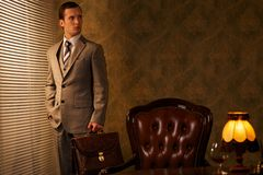 Man in grey suit with a briefcase Royalty Free Stock Photography