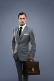 Man in grey suit with a briefcase Stock Photography