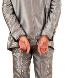 Man in grey suit with handcuffed hands Royalty Free Stock Images