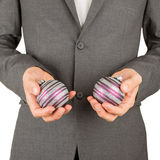 Man in grey suit is holding Christmass balls Royalty Free Stock Photo