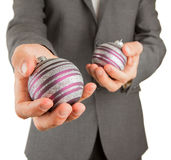 Man in grey suit is holding Christmass balls Royalty Free Stock Image