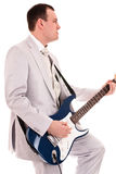 Man in grey suit playing guitar. White background Royalty Free Stock Photo