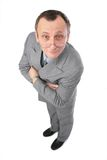 Man in grey suit watching Royalty Free Stock Photography