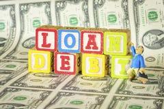 Man is grief stricken with loan debt Stock Photo