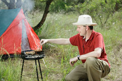 Man with grill royalty free stock photo