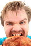 Man and grilled chicken Royalty Free Stock Photos