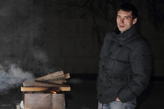 Man grilling at night with a fire that's too big. Ukraine Royalty Free Stock Photo