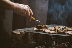 Man grilling pork meat chops on barbecue Royalty Free Stock Photos