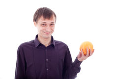 Man grimace holding sour fruit Stock Photography