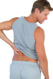 Man grimacing because of a back pain Royalty Free Stock Photo