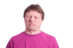 Man is grimacing his face. Man eat sour food and is making a grimace Royalty Free Stock Photo