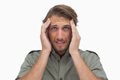 Man grimacing with pain of headache and looking up Stock Images