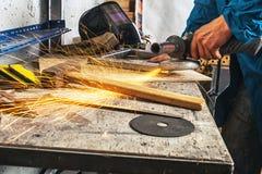 Man grinder metal an angle grinder royalty free stock image