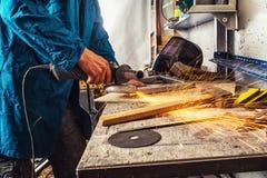 Man grinder metal an angle grinder Stock Photos