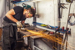 Man grinder metal an angle grinder Royalty Free Stock Image