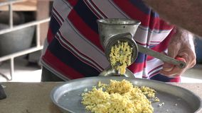 Man grinding corn for making tamales,tamale or tamal. Cuban man grinding corn for preparing tamales or tamal, traditional preparation of a traditional Latin stock video footage