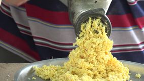 Man grinding corn for making tamales,tamale or tamal stock video footage
