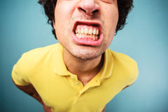 Man grinding his teeth Stock Image