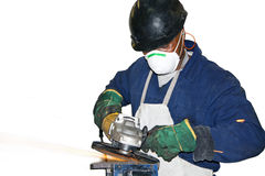 Man Grinding metal against white BG Royalty Free Stock Photos