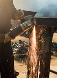 Man grinding metal with angle grinder. Man grinding metal with a angle grinder Royalty Free Stock Photo