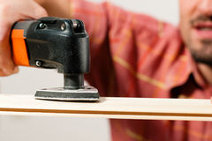 Man is grinding a plank Stock Photography