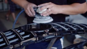Man grinds the grate before painting. The man grinds the grate before painting, for this he uses a grinding machine, antichromic grating stock footage