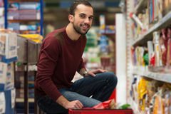 Man At Groceries Store Royalty Free Stock Photos