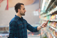 Man At Groceries Store Royalty Free Stock Photography