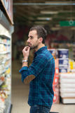 Man At Groceries Store Stock Photo
