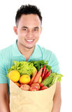 Man with a grocery bag Stock Photography