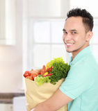 Man with a grocery bag Stock Photos