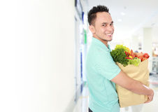 Man with a grocery bag Royalty Free Stock Images