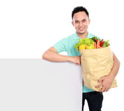 Man with grocery bag Stock Photo