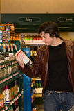 Man grocery shopping. In a grocery store Stock Image