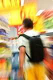 Man in grocery store. View from back on a man shopping in supermarket royalty free stock photos