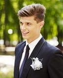 Man groom in park outdoor. Stock Image