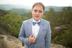 Man, groom posing near forest and lake Stock Photo