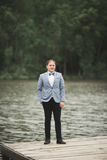 Man, groom posing near forest and lake Royalty Free Stock Photo