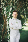 Man, groom posing in park on his wedding day Royalty Free Stock Photos