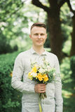 Man, groom posing with perfect wedding bouquet Royalty Free Stock Photography
