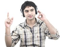 Man grooving to the music. Asian male of indian origin listening to music Stock Photo