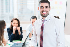 Man and group having business meeting in office Royalty Free Stock Photos